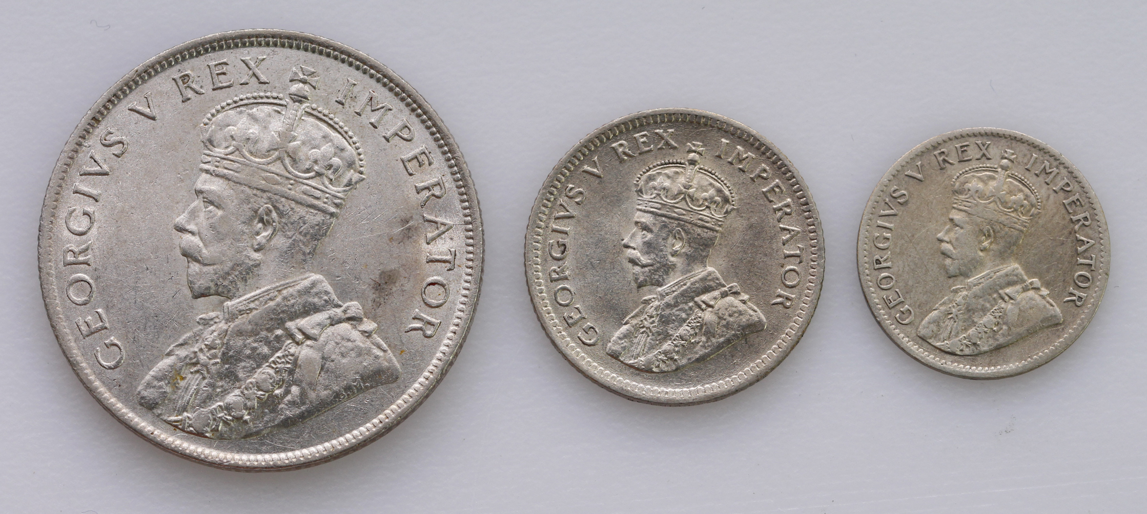South Africa (3): Florin 1928 aEF, Sixpence 1929 EF, and Threepence 1925 wreath type VF, light