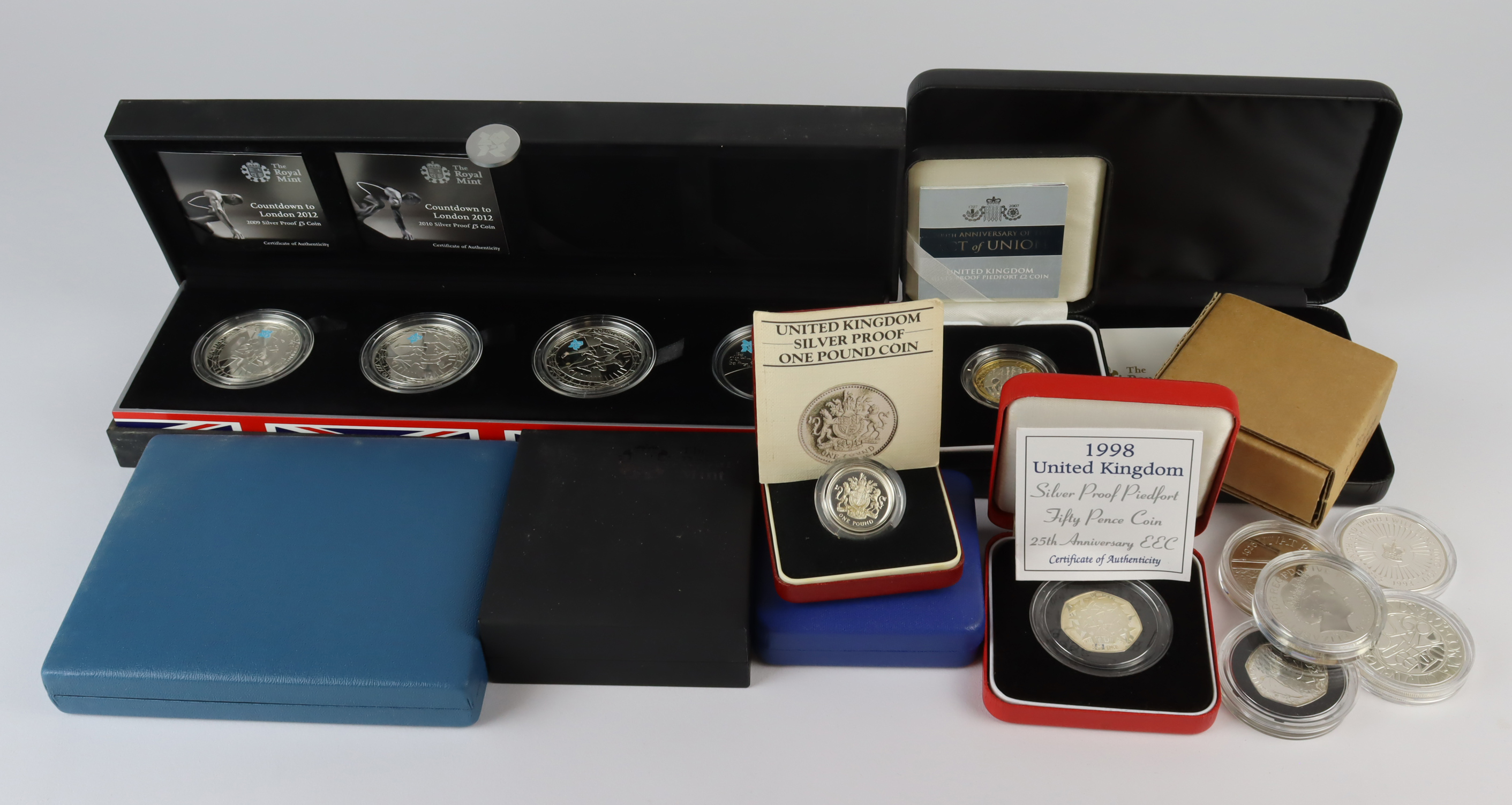 GB Silver Proof issues. An assortment of silver proof issues to include part sets, toned items
