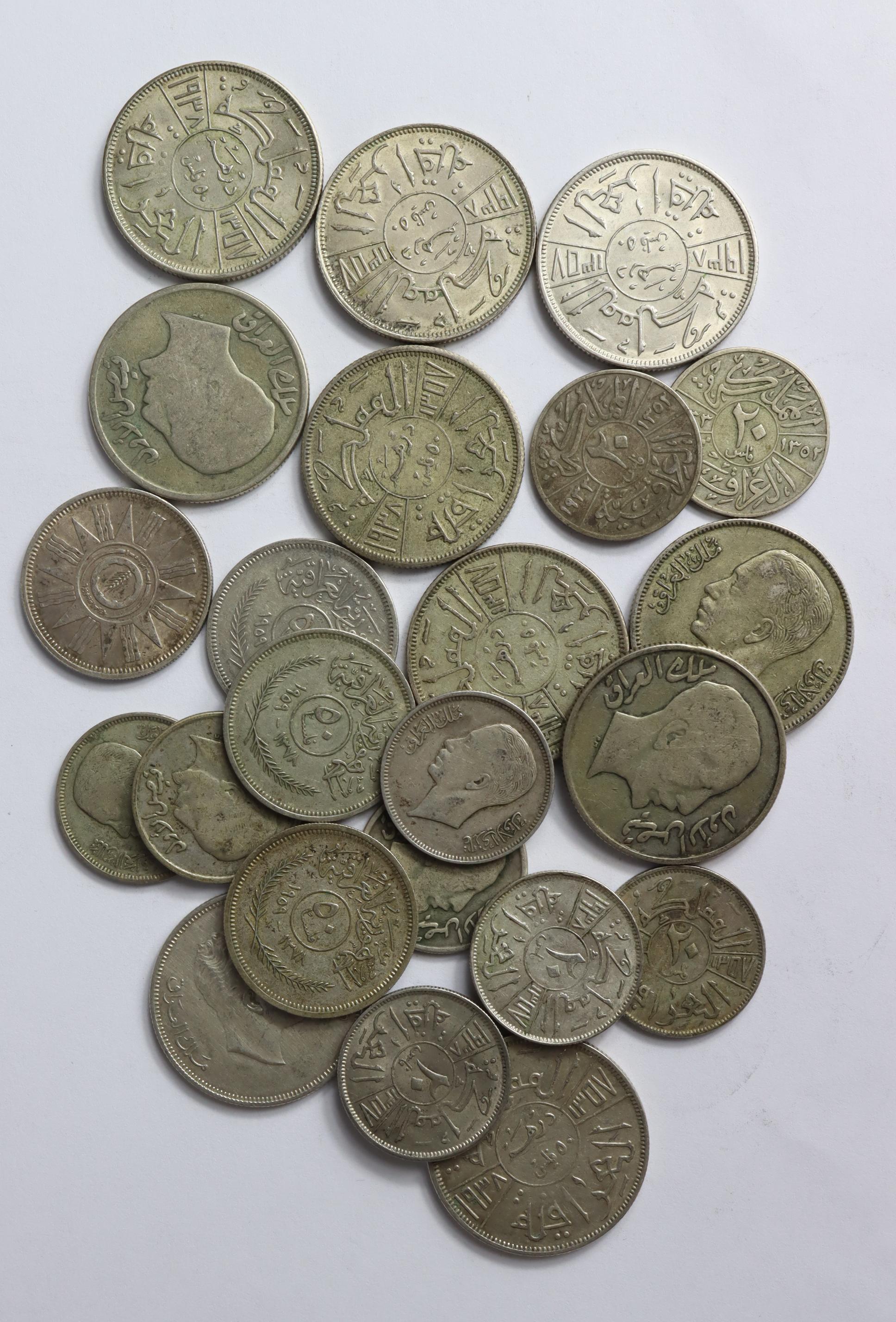 Iraq silver coins (23) 20thC, mixed grade.