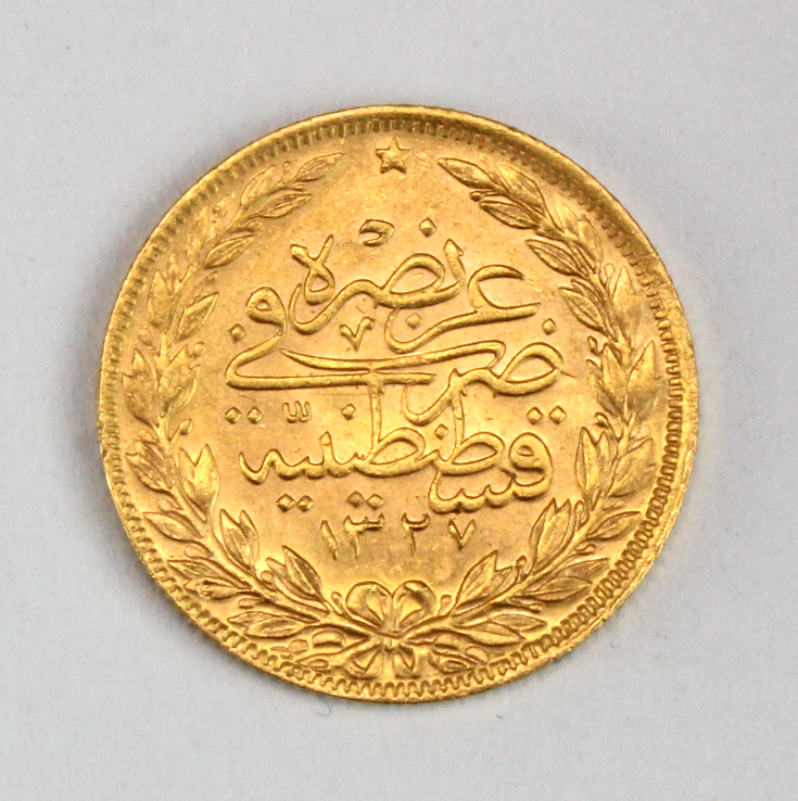Turkey gold 100 Kurush AH1327//8, EF, light scratch. (0.2127 troy oz AGW)