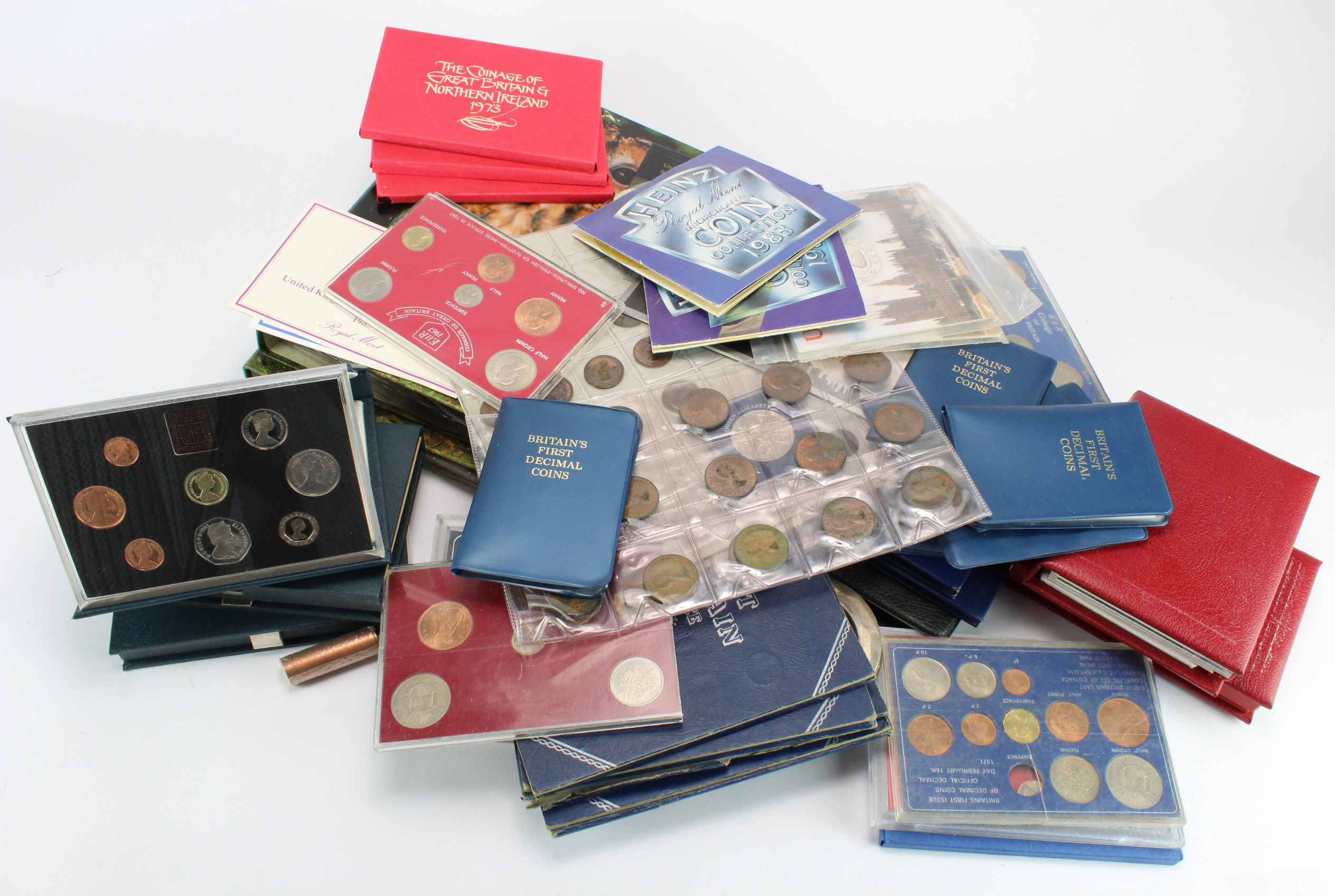 Assortment of mainly GB in a stacker box. Includes Proof sets, Whitman folders, album pages etc,