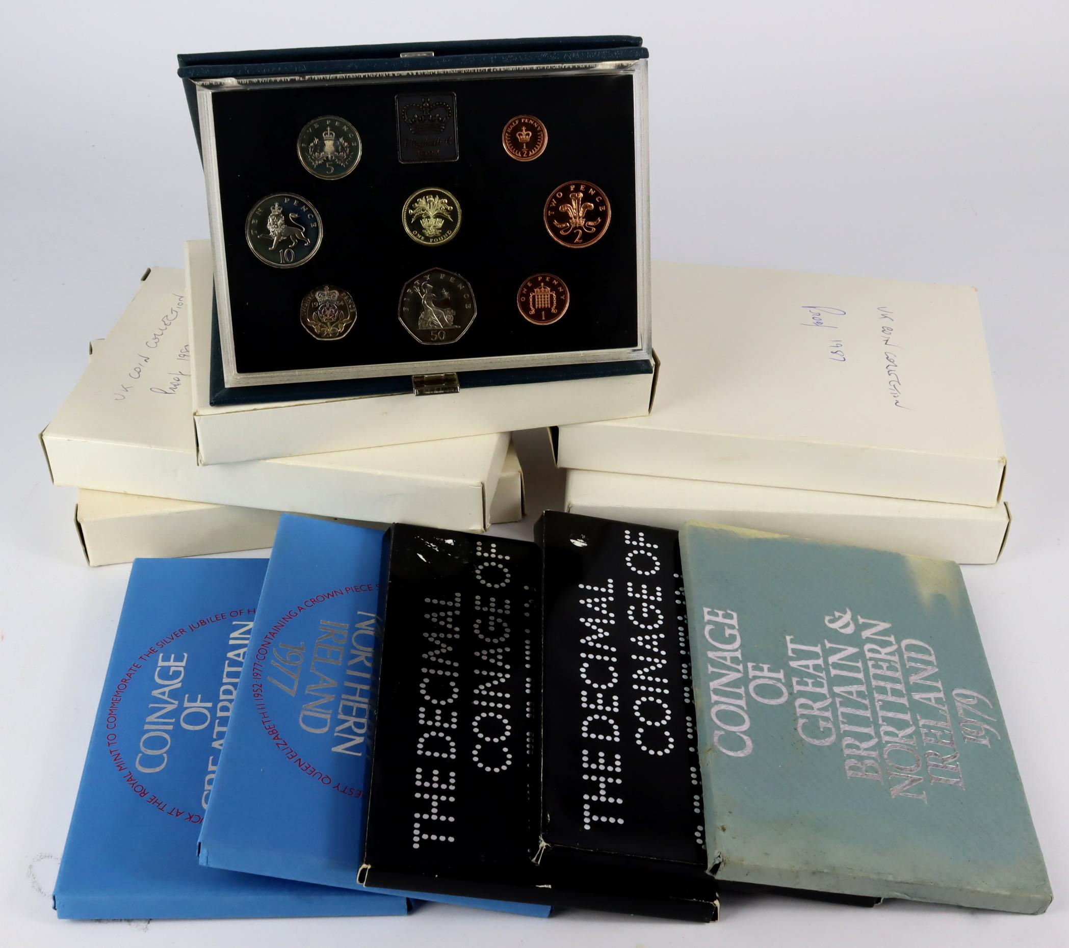 UK Proof Sets (10): Flat packs: 1971 x2, 1977 x2, 1979. Standard blue: 1983, 1984, 1985, 1986, and