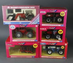 Britains. Five boxed models, comprising Case IH Magnum 310 Tractor (42113); Ford FW-30 Tractor (
