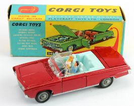 Corgi Toys, no. 246 'Chrysler Imperial' (red), complete with driver, passenger & golf clubs in boot,
