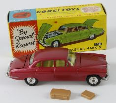 Corgi Toys, no. 238 'Jaguar Mark X' (cerise), suitcase in boot, contained in original box