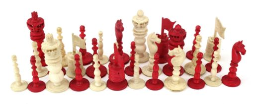 An Anglo-Indian, (possibly vizagapatam), carved ivory (natural) and horn (red stained), chess set,