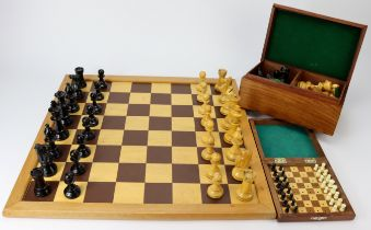 Chess interest. Two complete sets of Staunton style chess pieces, together with a cased Chess set by