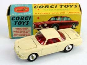 Corgi Toys, no. 239 'Volkswagen 1500 Karmann Ghia' (cream), with one suitcase, contained in original