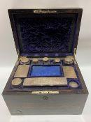 Victorian Coromandel brass inlaid vanity box, the hinged-lid revealing eight silver lidded bottles