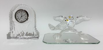Swarovski crystal bird group upon a mirrored base and with an original cylindrical box; together