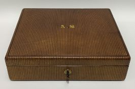 An Edwardian tooled leather writing box by W. Leuchars, maker, 38, Piccadilly, London, the brown