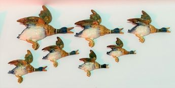Set of seven Beswick Pottery flying duck wall plaques, no. 596-02 to 596-04 including pair of 596-