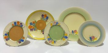Two Clarice Cliff Newport Pottery crocus pattern plates, together with three crocus pattern side