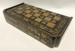 A 19th Century Chinese export black lacquer and gilt decorated hinged games box, the lid and base