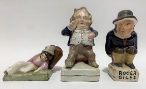A Victorian Staffordshire pottery figure of a portly seated gentleman, height 14cm; together with