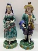 Pair of continental majolica figures, early 20th Century, modelled as a 17th Century man and