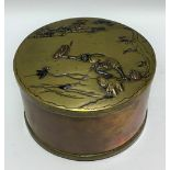 Meiji period Japanese mixed metal circular box, the slightly domed lid decorated with a fisherman in