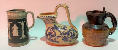 19th Century sprigged stoneware hunting jug with greyhound handle, height 16cm; together with a
