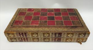 A 19th Century tooled and gilt leather folding book style chest and backgammon board, 45cm x 25.