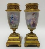 A pair of painted porcelain gilt bronze mounted pedestal garniture vases, the fluted & beaded collar