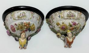 Pair of German porcelain flower encrusted wall brackets, foliate painted and with courting couple