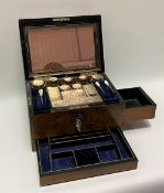 A Victorian burr walnut ladies vanity box, the hinged lid with brass inset shield and ribbon