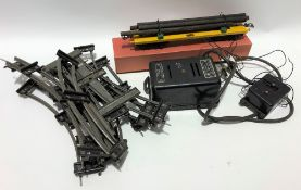 Model railway O gauge track together with a power unit no. 1 by International Model Aircraft Ltd and