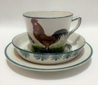 Wemyss ware cockerel and chicken decorated trio with impressed and printed marks for T. Goode & Co