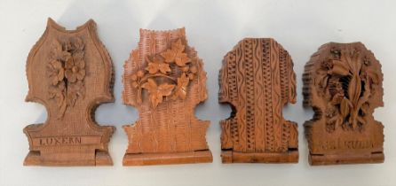Four 19th century Black Forest carved pocket watch holders.