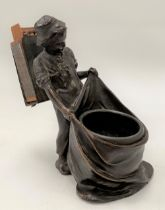 A bronzed spelter figural matchbox holder in the form of a boy holding a sack, height 14cm.