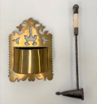 A silver plated candle snuff with ivory knopped handle, length 28.5cm; together with a brass wall
