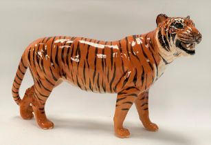 A Beswick Pottery model of a tiger, length 30cm.