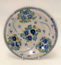 An 18th century English Delft foliate decorated dish, diameter 23.5cm.