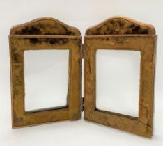 A Victorian brass and velvet covered double folding photograph frame, height 23cm.