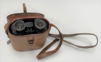A pair of Goerz Berlin Trieder binoculars in brown leather case, the case lid inset with a compass.