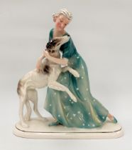 An Art Deco German porcelain group depicting a woman and Afghan hound by Porzllanfabrik Hertwig &