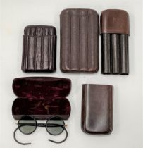 Three leather cigar cases, together with a cased pair of vintage spectacles (4).