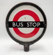 A vintage enamel bus stop sign, diameter 33cm, together with an enamelled bus stop request sign,