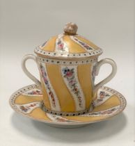 A 19th century Sevres lidded chocolate pot with twin handles and on saucer dish, painted with floral