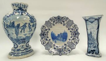 A Dutch delft blue and white baluster relief moulded vase, decorated to one side with three