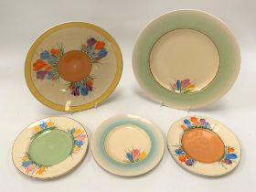 Two Clarice Cliff Newport Pottery crocus pattern plates; together with three crocus pattern side
