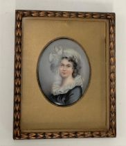 A porcelain printed and painted oval panel decorated with a girl, 8 x 6.5cm within a gilt mount
