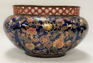 A Zsolnay Pecs oval lobed jardinière with pierced rim and painted with foliate scrolls with gilded