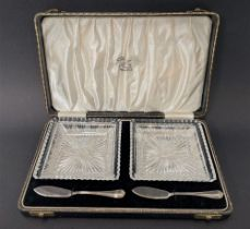 A George VI cut glass pair of butter dishes with silver butter knives, Sheffield 1938, weight of