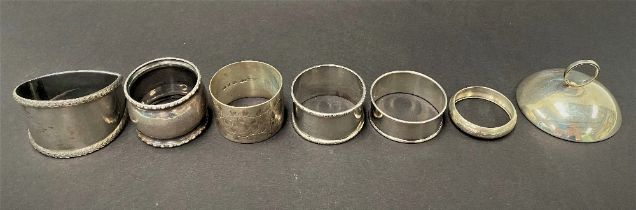 Six various silver napkin rings, five with hallmarks, the other stamped SILVER, together with a