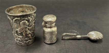 A Victorian silver export embossed miniature cup decorated with two putti amongst foliate scrolls