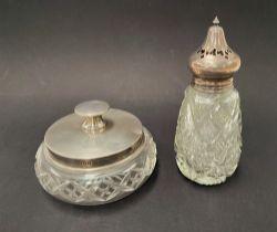 A silver lidded cut glass squat circular powder jar, Birmingham 1933, together with a silver