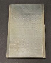 A George VI silver engine turned cigarette case, the interior with engraved monograms and dates,