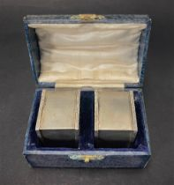 A pair of George VI heavy engine turned square section napkin rings within fitted case, maker T & S,