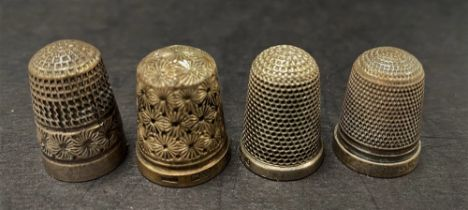 An Edwardian silver thimble by Charles Horner, Chester 1903, together with three other silver